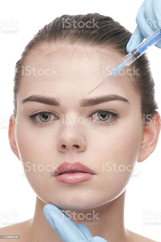 botox injection to the face of beautiful woman royalty-free stock photo
