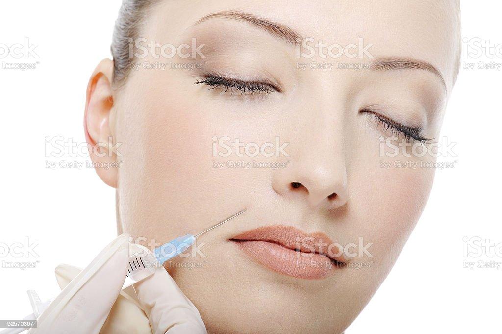 botox shot in the female cheek royalty-free stock photo