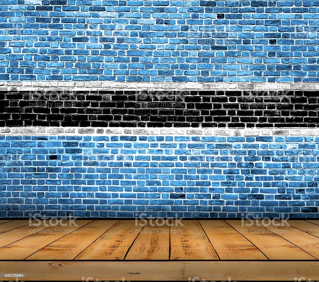 Botswana flag painted on brick wall with wooden floor stock photo