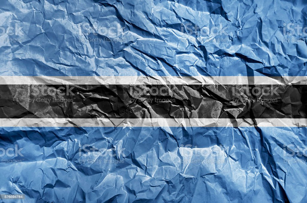 Botswana flag painted on crumpled paper background stock photo