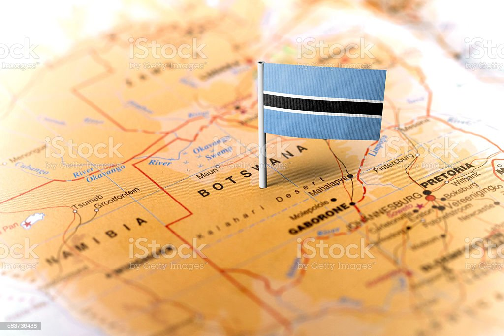 Botswana pinned on the map with flag stock photo