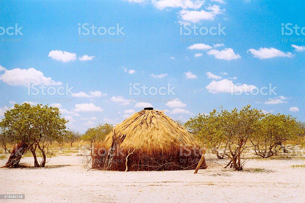 Botswana: San Bushmen Grass Hut, Pretty Blue Sky stock photo