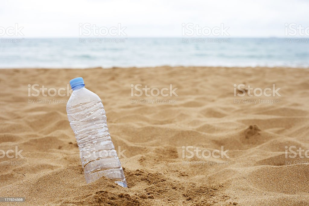 Bottle Abandoned on the Beach royalty-free stock photo