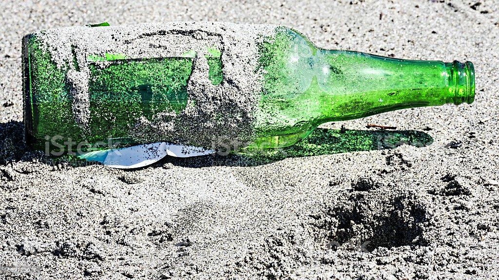 Bottle abandoned on the beach stock photo
