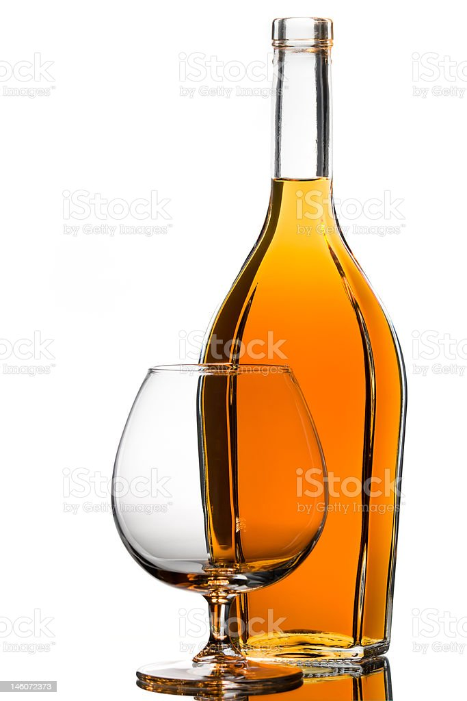 Bottle and an empty glass royalty-free stock photo