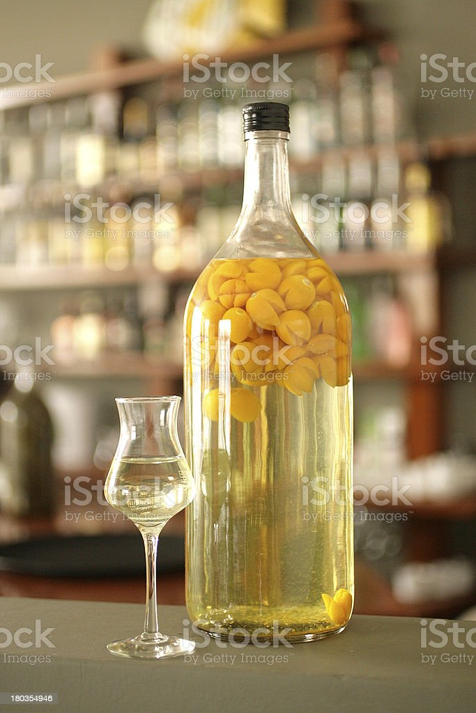 Bottle and cup of guaymanto fruit macerated in peruvian pisco stock photo