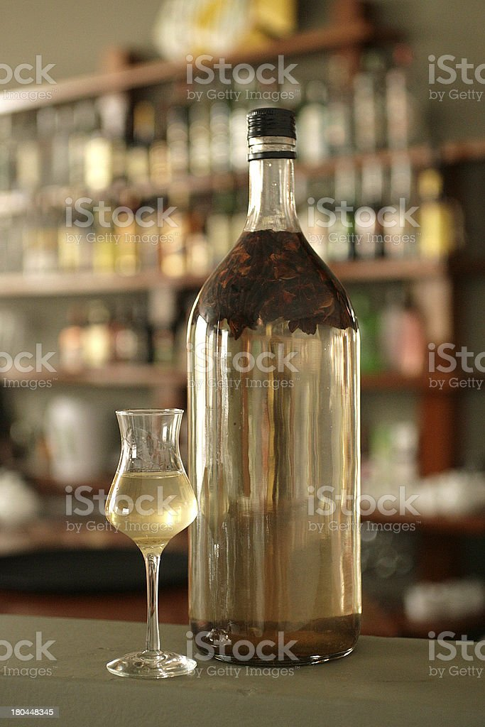 Bottle and cup of star anise macerated in peruvian pisco stock photo