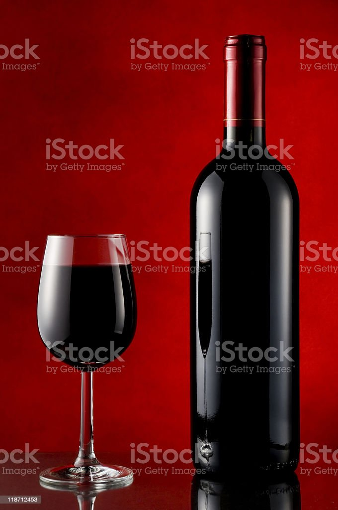 Bottle and glass of red wine stock photo