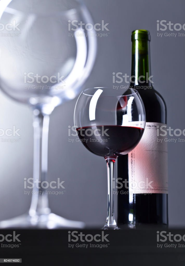 Bottle and glass of red wine . stock photo