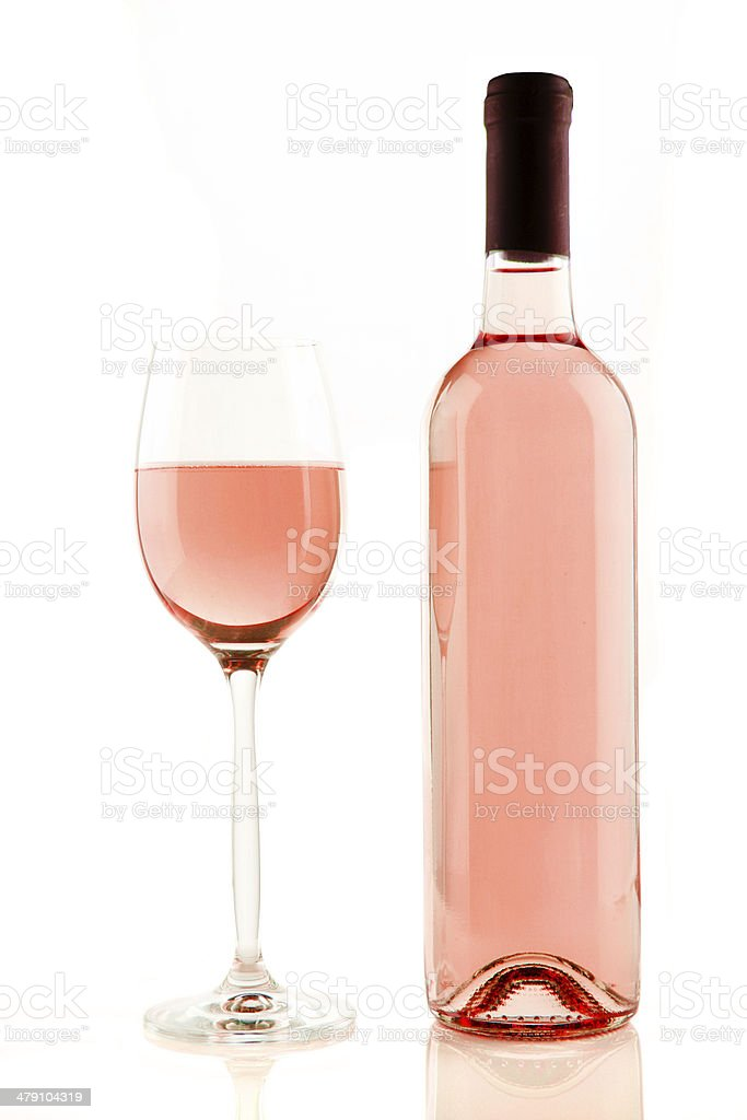 Bottle and glass of rose wine isolated stock photo