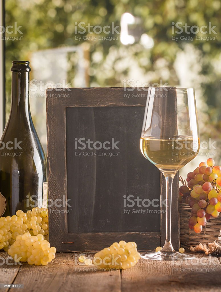 Bottle and glass of wine with grapes stock photo