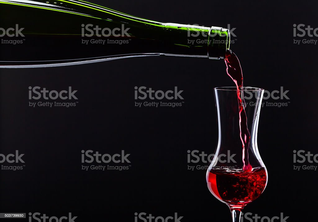 bottle and glass with alcoholic drink stock photo