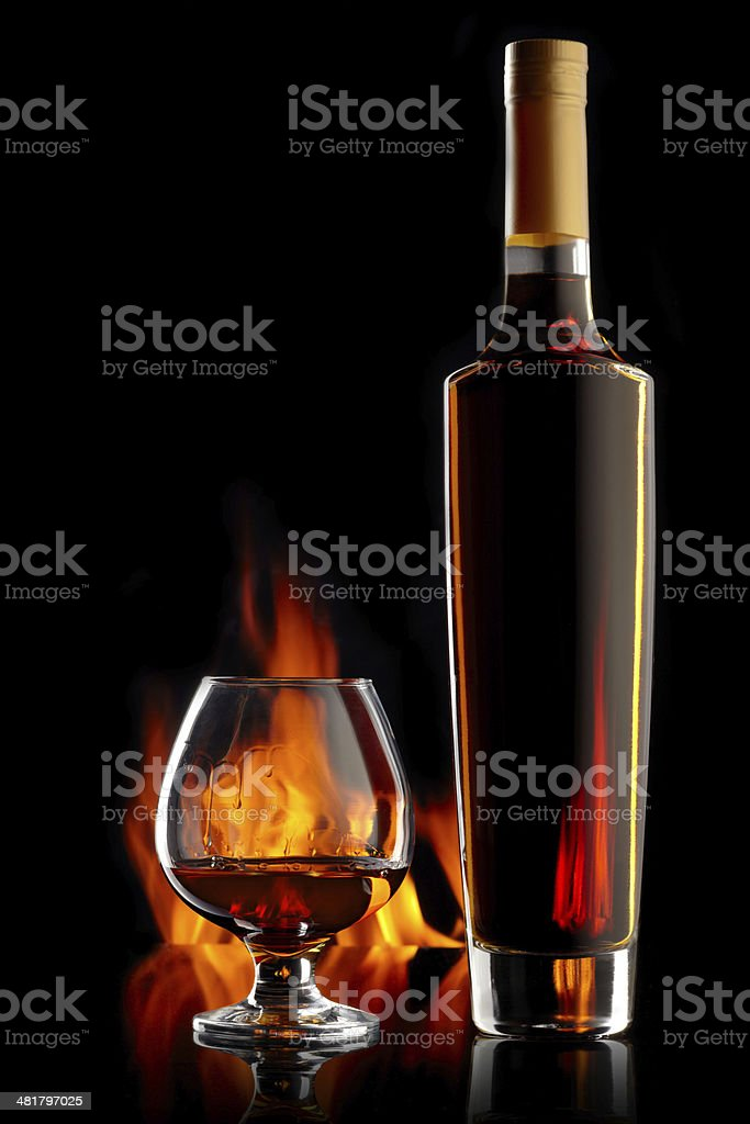 Bottle and glass with cognac stock photo