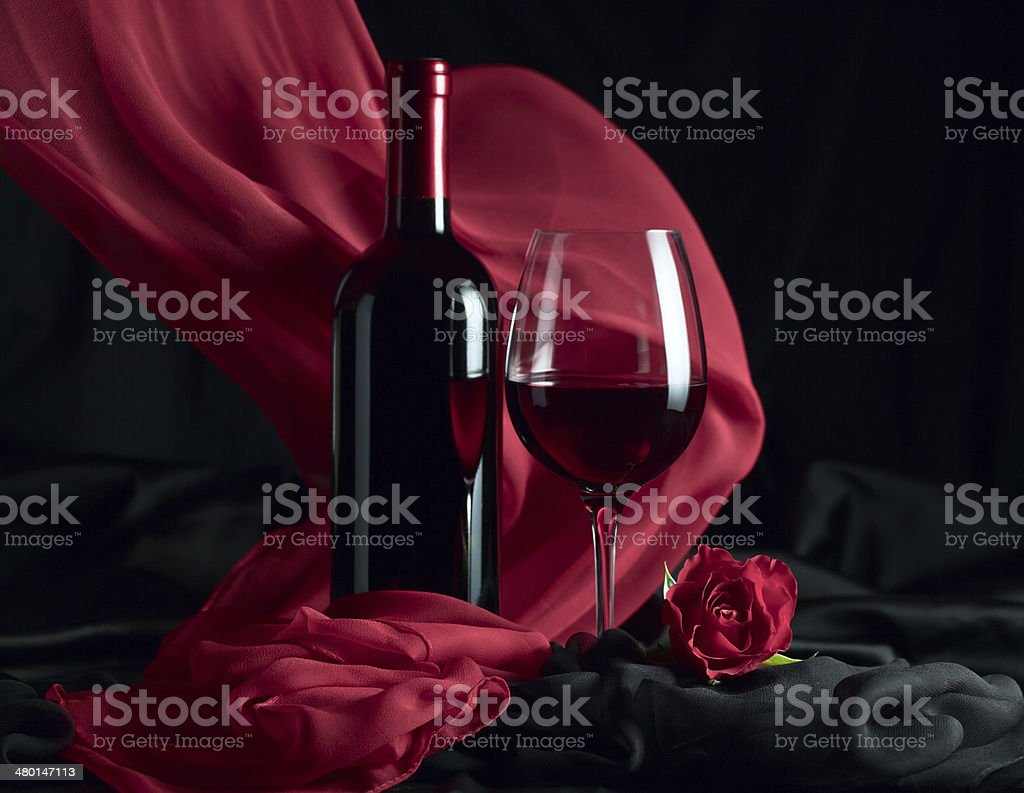 bottle and glass with red stock photo