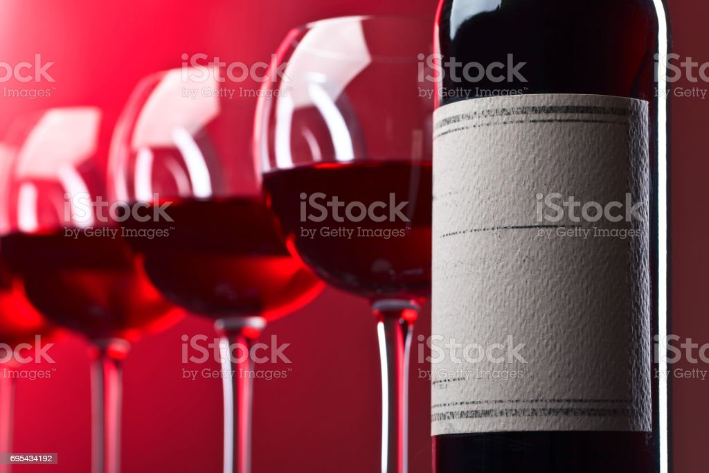 Bottle and glasses of red wine stock photo