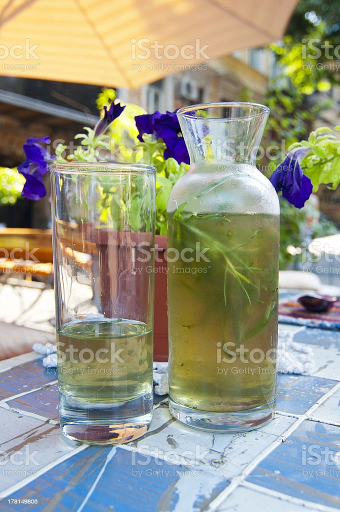 Bottle and glasses  with herb inside royalty-free stock photo