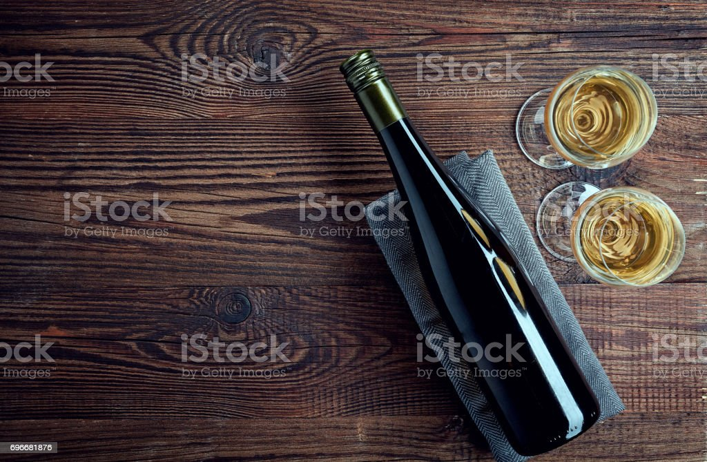 Bottle and two glasses of white wine stock photo