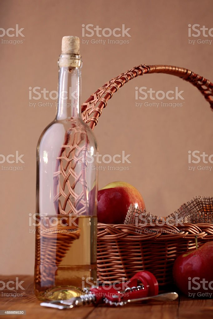 Bottle, basket, apples and corkscrew stock photo