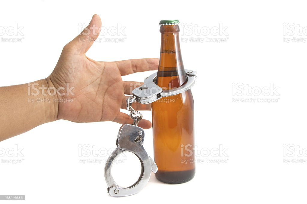 bottle beer and handcuffs,Drunk driving concept stock photo