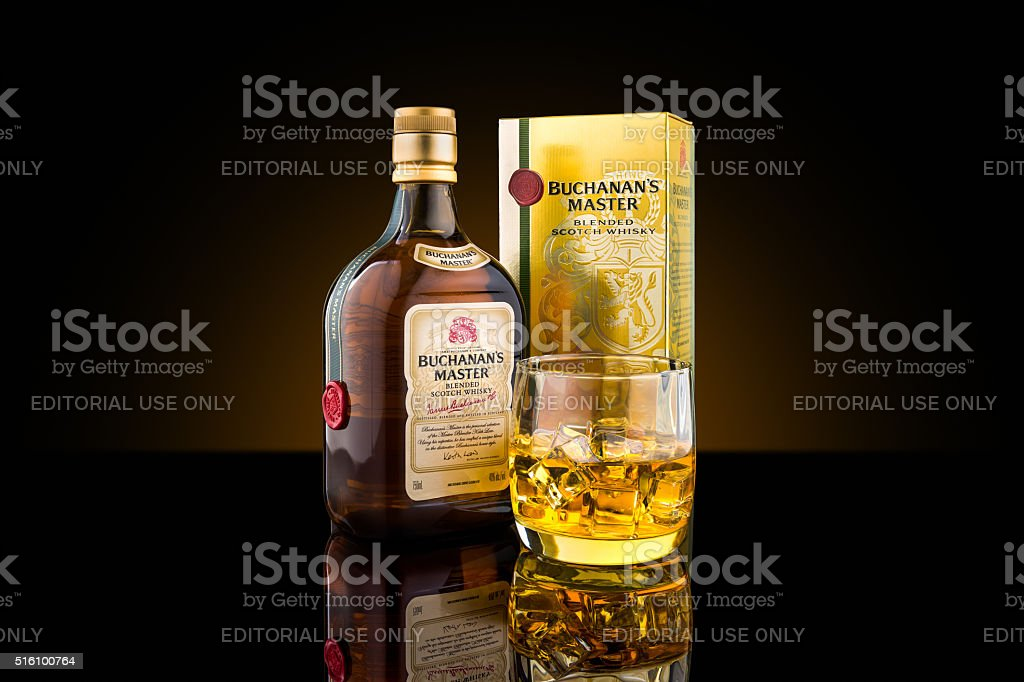 Bottle, box and glass of Buchanan's Master blended scotch whisky stock photo