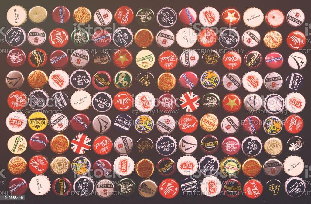 Bottle caps background in retro style stock photo