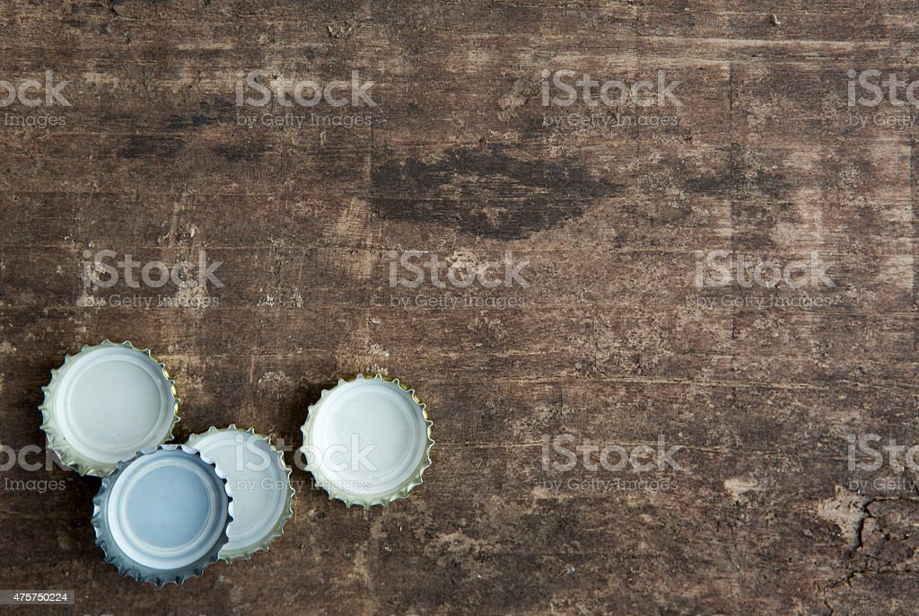 bottle caps on rustic wooden background stock photo