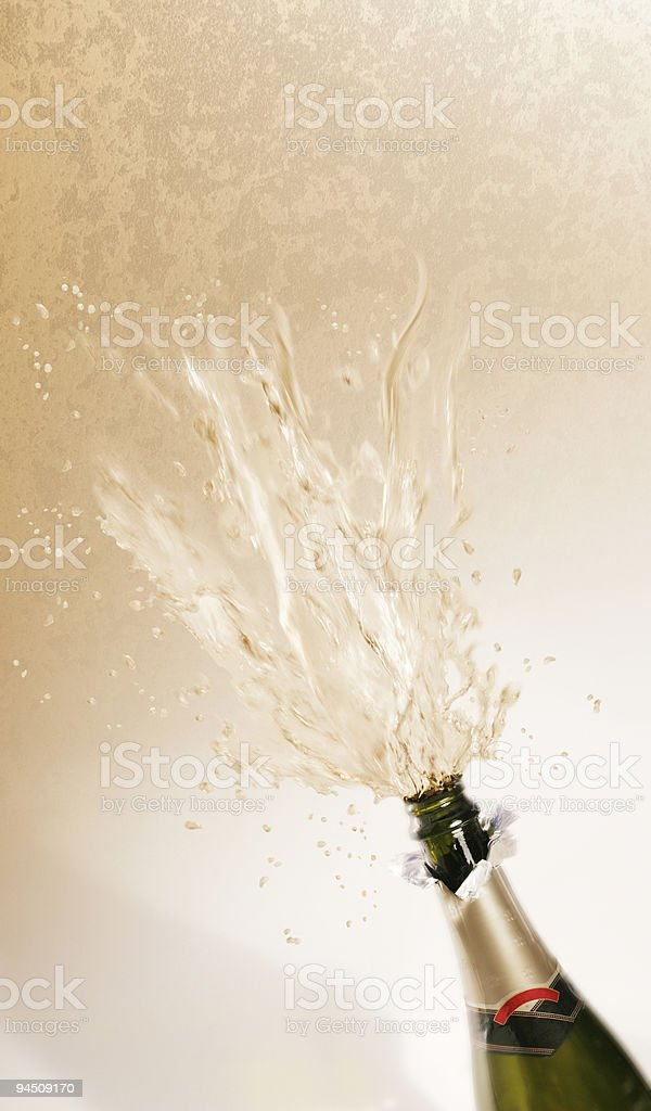 Bottle champagne exploding royalty-free stock photo