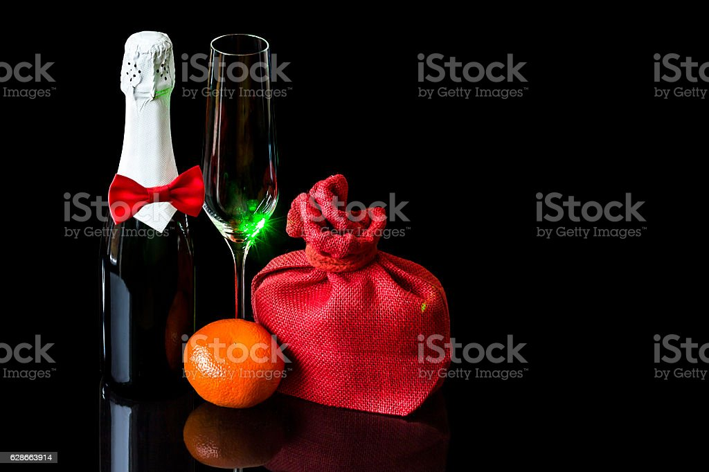 Bottle champagne with wineglass and gift in bag stock photo