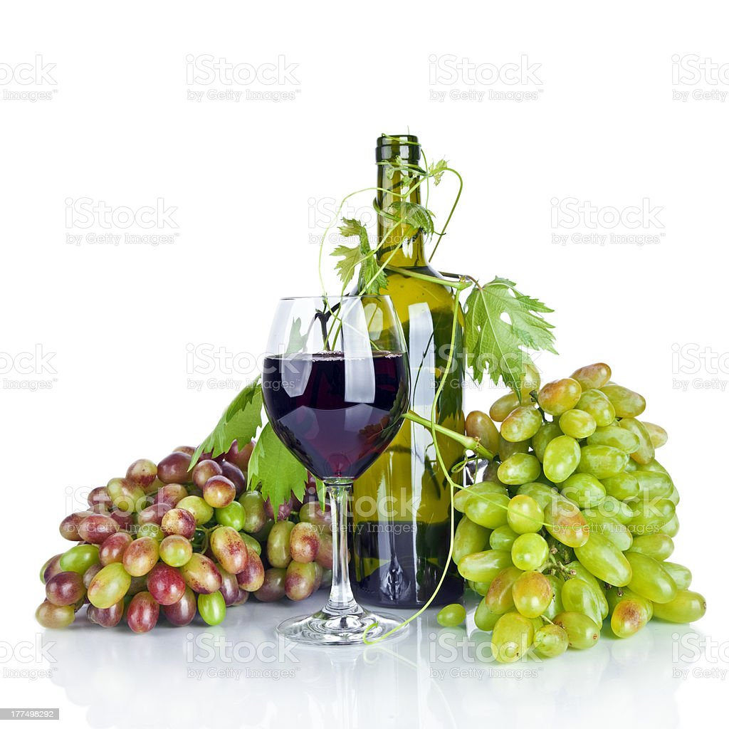 bottle, glass of wine and ripe grapes isolated on white royalty-free stock photo