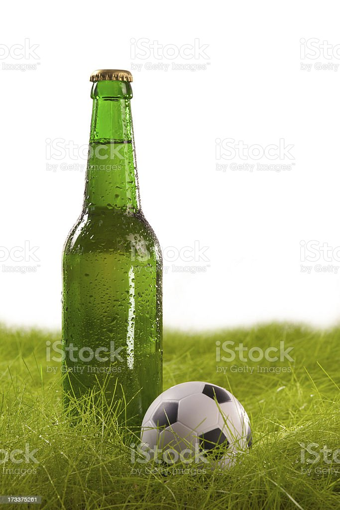 Bottle of beer and small soccer ball. Isolated on white. royalty-free stock photo