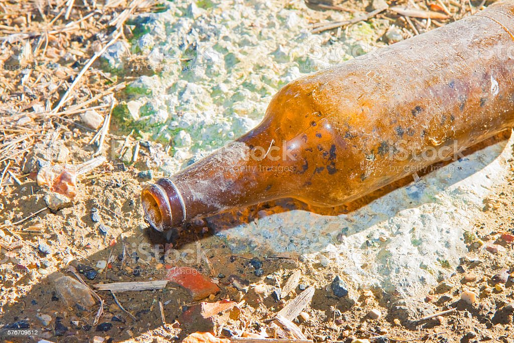 Bottle of beer glass abandoned on the gound stock photo