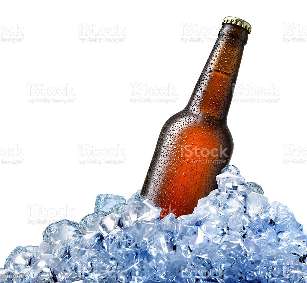 Bottle of beer in ice stock photo