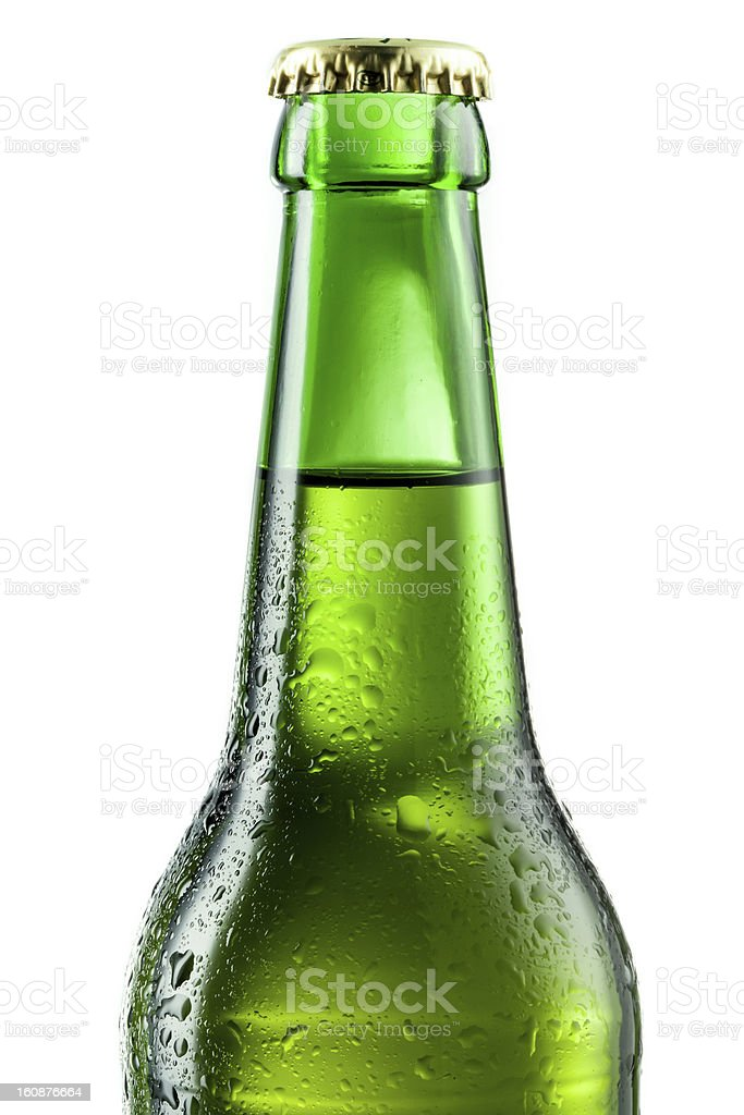 Bottle of beer with drops isolated on white. stock photo