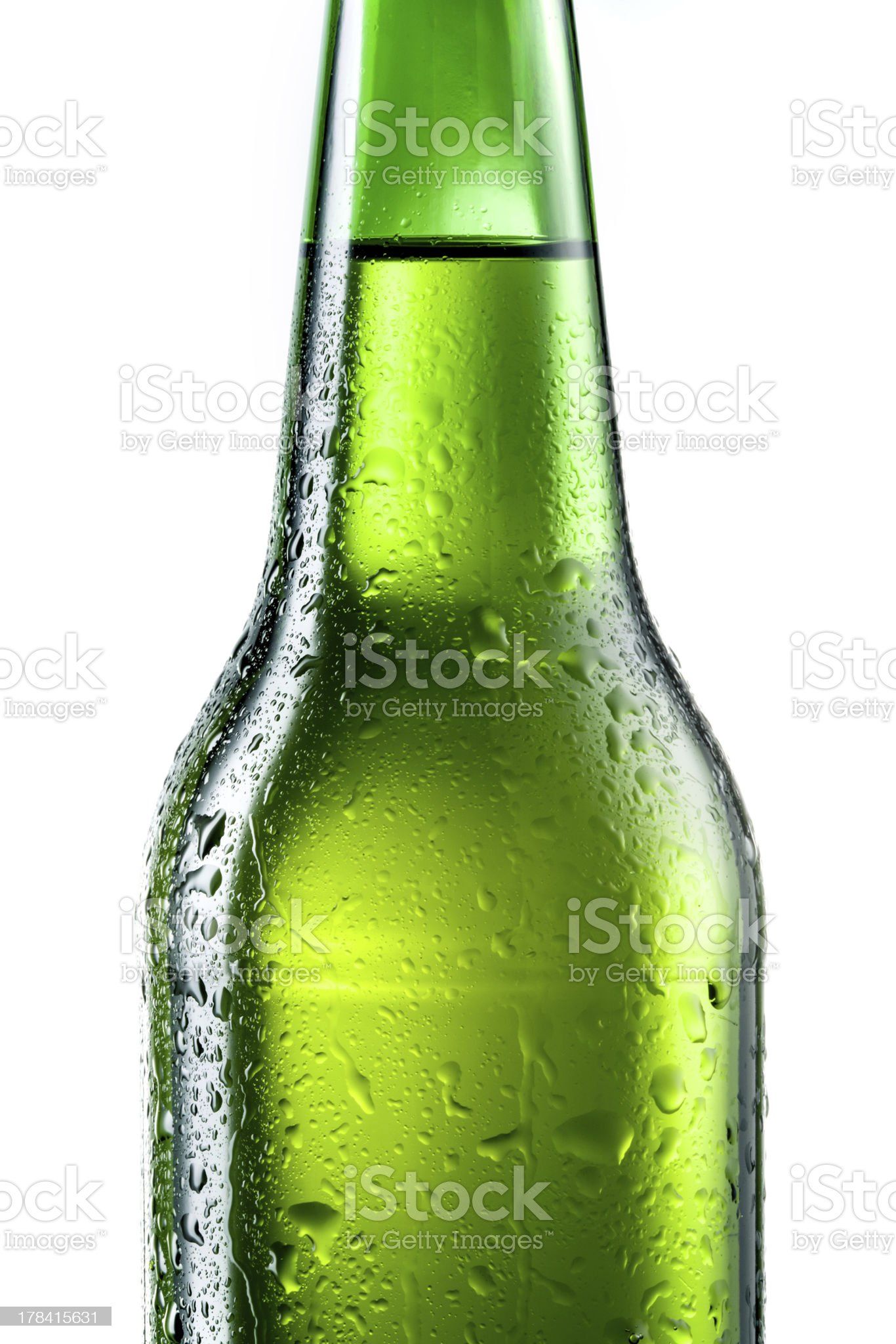 Bottle of beer with drops isolated on white royalty-free stock photo