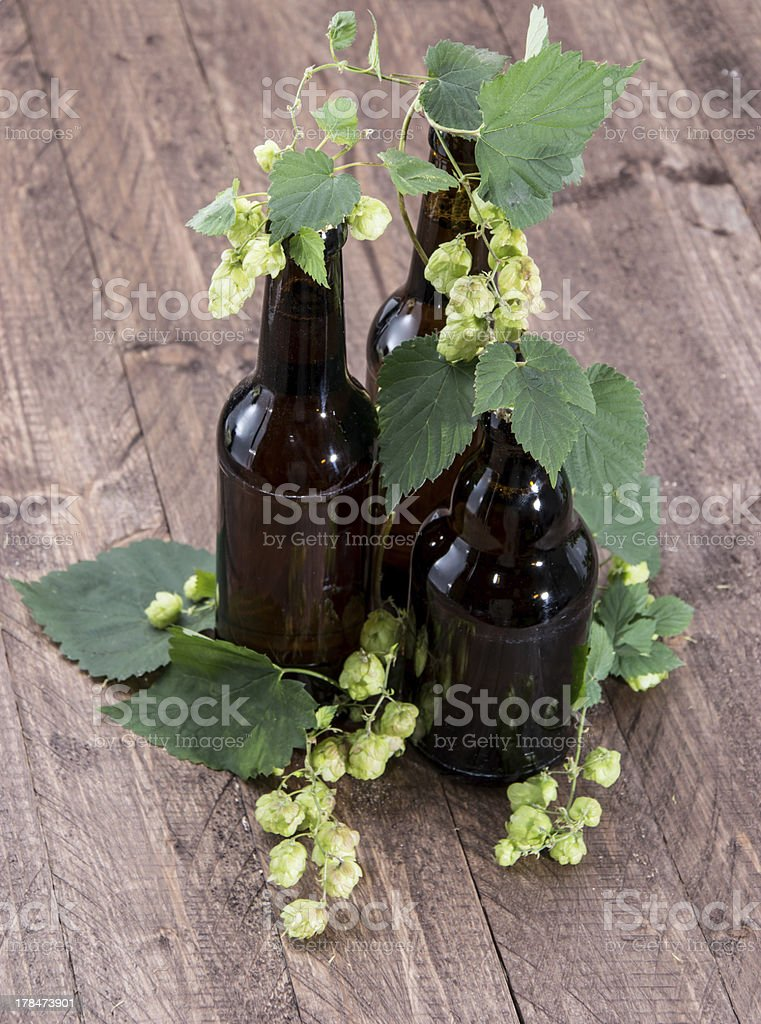 Bottle of Beer with Hops on wood royalty-free stock photo