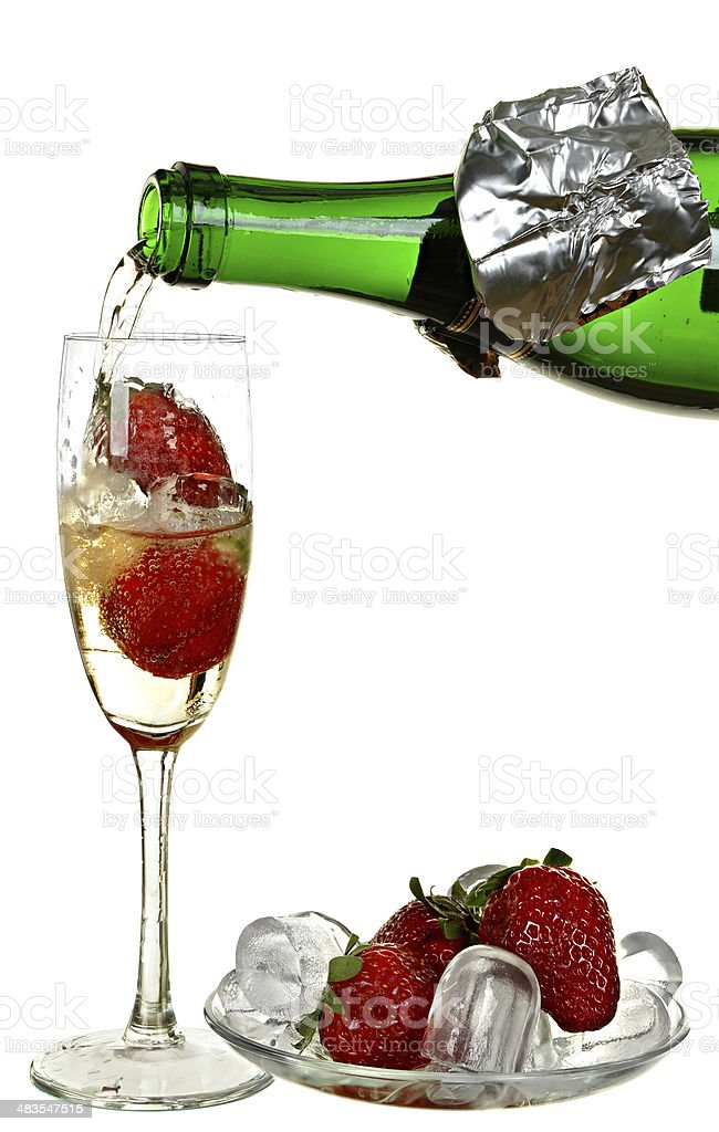Bottle of champagne, wine, strawberry and ice stock photo