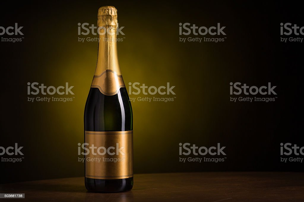 bottle of champagne with blank golden label stock photo