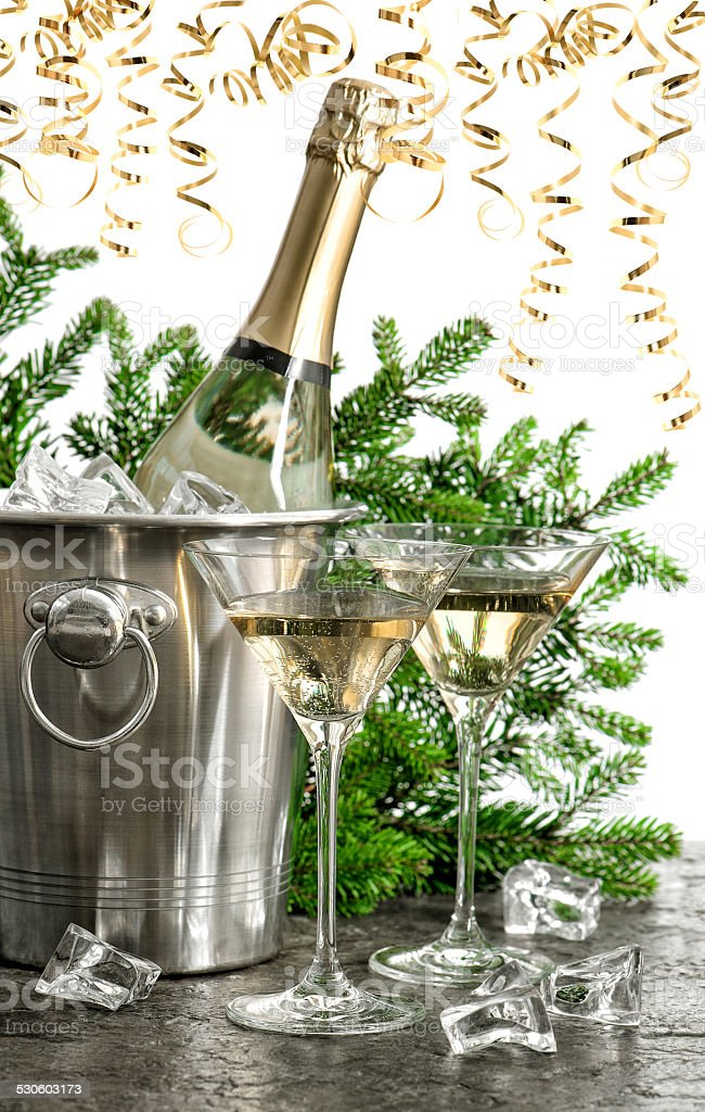 bottle of champagne with two glasses stock photo