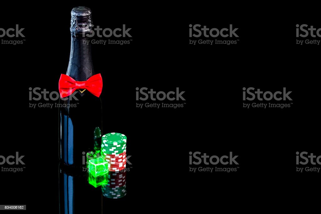 Bottle of champagne with wineglass and colorful chips stock photo