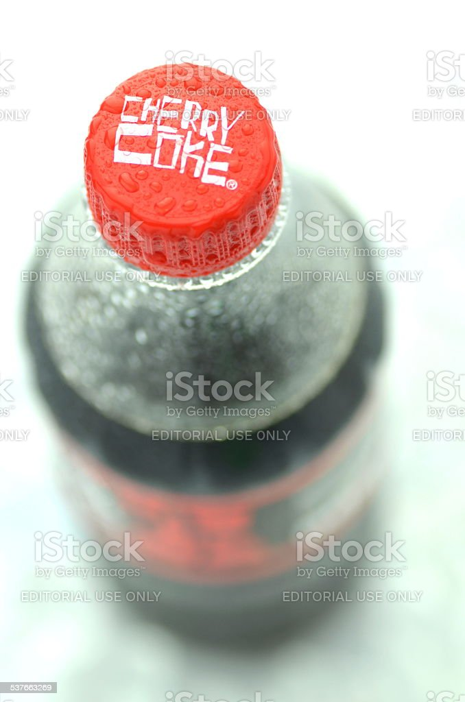 Bottle of Cherry Coke drink isolated on white stock photo
