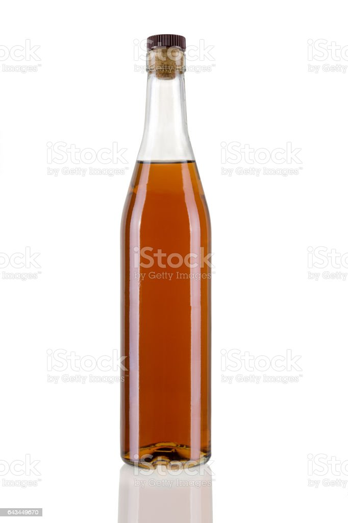 Bottle of cognac isolated on white background stock photo