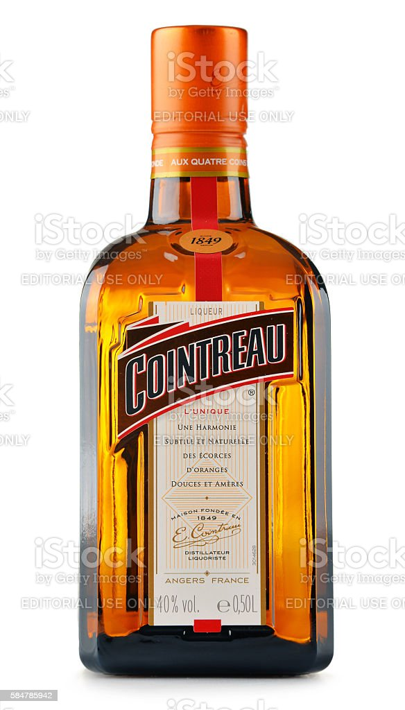 Bottle of Cointreau triple sec isolated on white stock photo