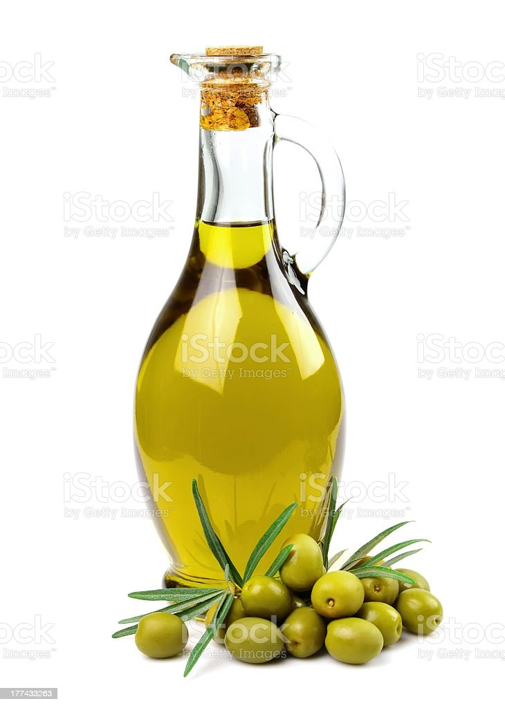 Bottle of corked olive oil and fresh green olives stock photo