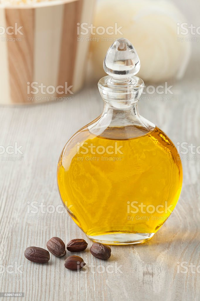 Bottle of cosmetic Jojoba oil stock photo