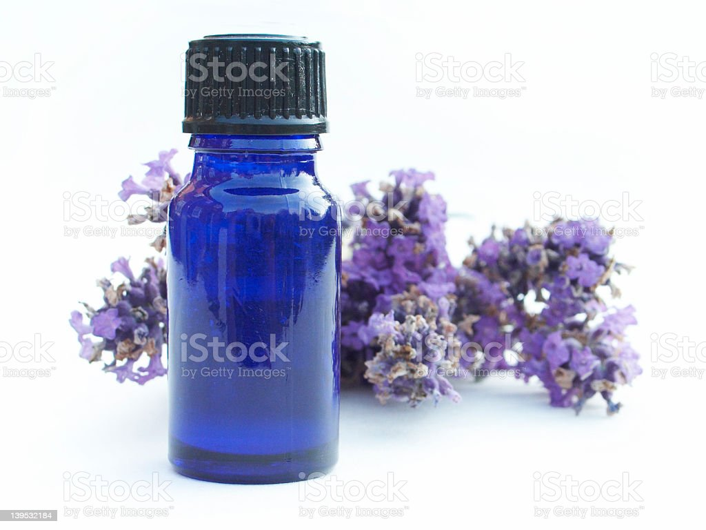 A bottle of essential lavender oil stock photo