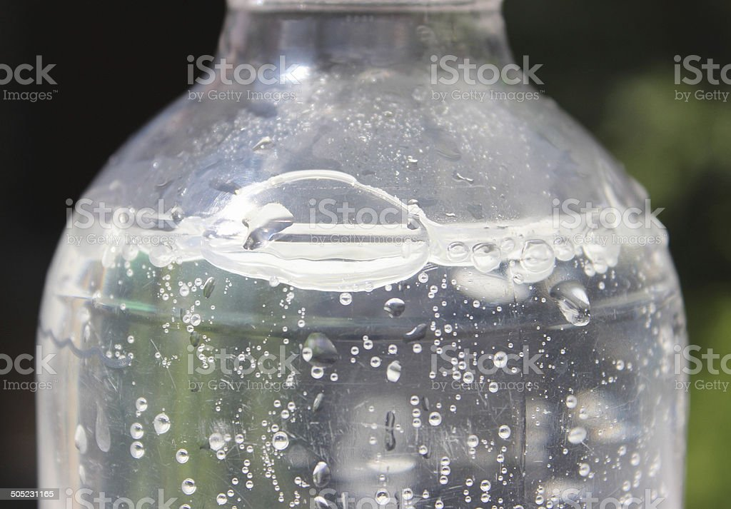 Bottle of fizzy water image, soda water with carbon-dioxide bubbles stock photo