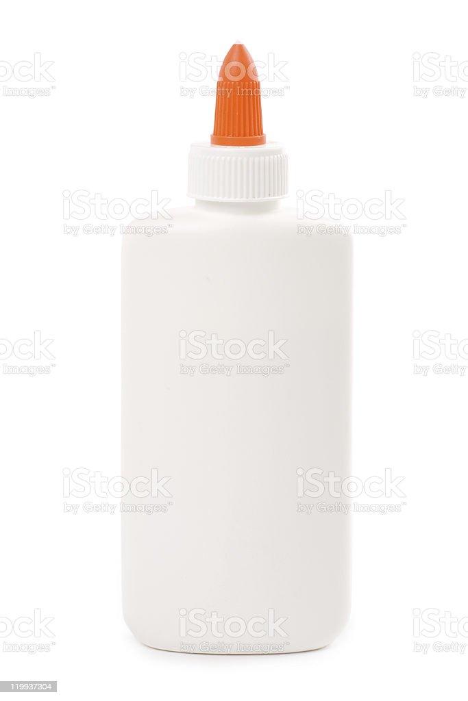 Bottle of glue with orange tip on white background stock photo