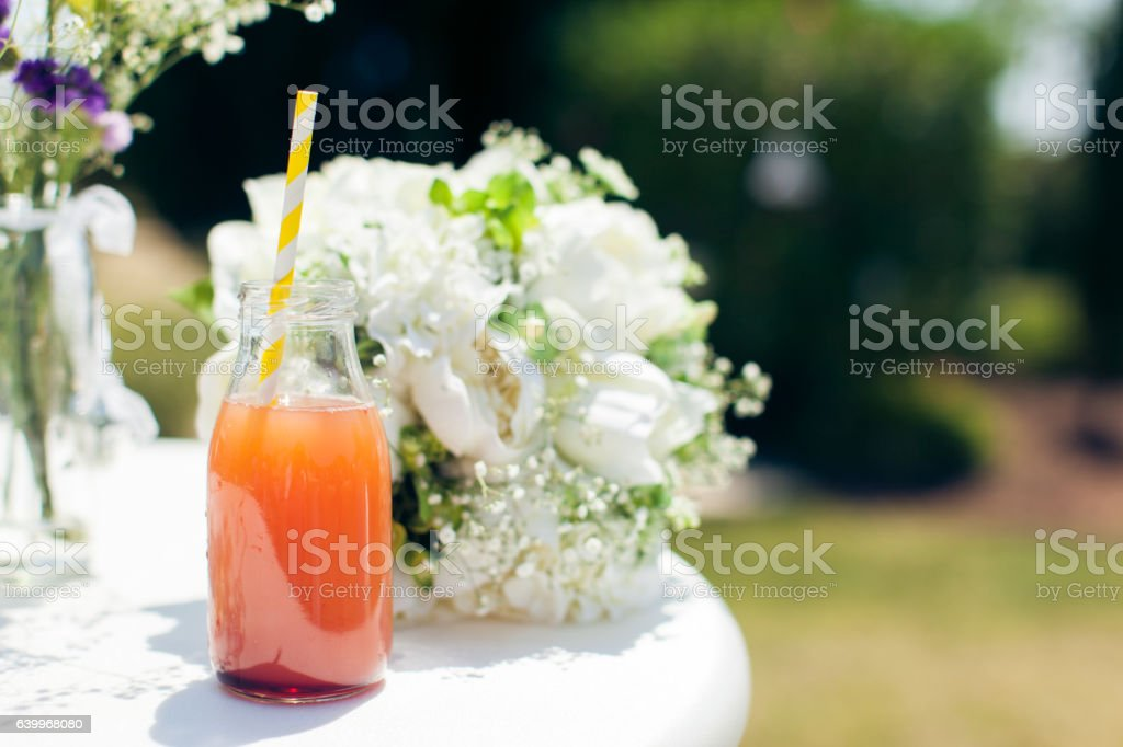 bottle of juice for  white wedding bouquet stock photo