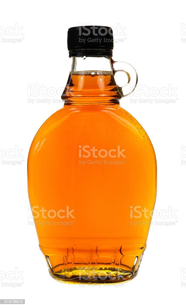 Bottle of maple syrup stock photo