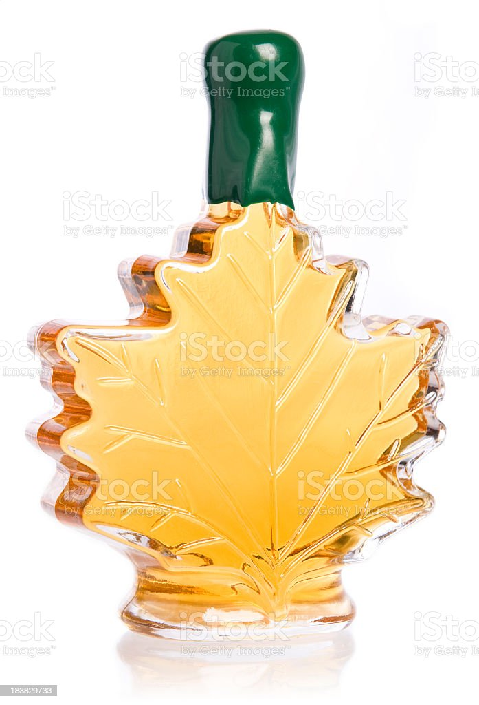 A bottle of maple syrup with green cap royalty-free stock photo